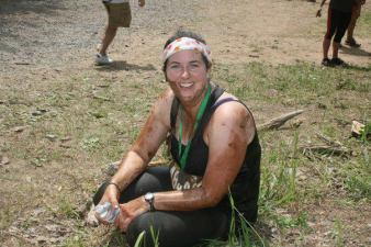 "Me ""sitting"" minutes after  I finished my first ever Mud Hero (7 months post pardum!)"