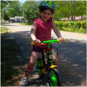 Small bike a.k.a. balance bike and Lilly dressed herself :)