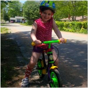 Small bike a.k.a. balance bike and Lilly dressed herself :)